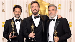 "The production team for ""Argo,"" from left, Grant Heslov, Ben Affleck, and George Clooney."