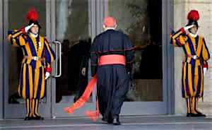 A cardinal arrives at the Vatican Monday to begin the work of electing a new pope.