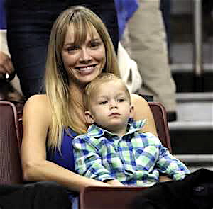 The coach's wife, Amanda Marcum with her son at the Georgetown game.