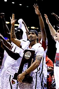 Senior guard Peyton Siva taking in the scene, and trophy after winning a championship.