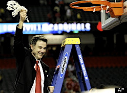 Rick Pitino cutting down the nets after defeating Michigan.