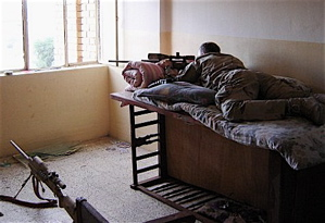 Chris Kyle set up in an improvised sniper hide, using a baby crib.