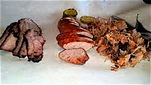 Brisket, andouille sausage and pulled pork make a tasty 3-meat combo.