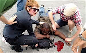A shooting victim is attended to at the Mother's Day parade in New Orleans.