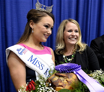 Miss Kentucky Jenna Day, and Angela Osting posed with the grand champion ham following the 50th annual Kentucky Farm Bureau Country Ham Breakfast. Osting, representing the Yum! Brands Foundation, placed the winning bid of $350,000 with proceeds going to charity.