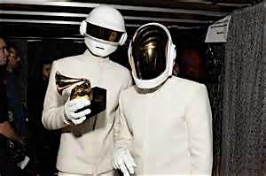 The robots of Daft Punk showing off one of their multiple Grammy's from Sunday.