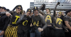 Iowa students showing their rowdy spirit at a home football game. (AP photo courtesy of Charlie Neibergall)