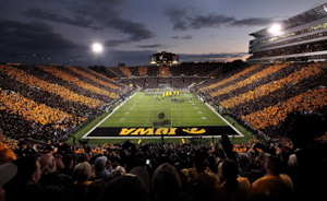 Kinnick Stadium at night, named after Nile Kinnick, the 1939 Heisman Trophy winner who played for the Hawkeyes.