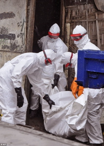 Officials in Liberia remove a victim of Ebola.