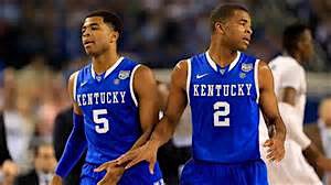 "Kentucky's twin 6'6"" starting guards Andrew Harrison (L) and Aaron Harrison (R)."