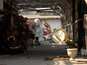Dilapidated Mardi Gras floats left soaked in storage.