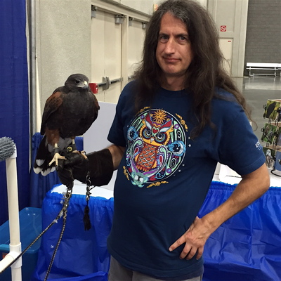 Chris Allmän with Sade, a Harris Hawk.