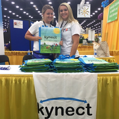 kynect staff members Shelby Warren, left, and Jasmine Hall, working the health exchange booth at the 2015 KY State Fair.