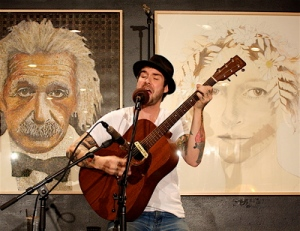 Whitmore performing at the Java House in Iowa City | Photo by Julie Staub