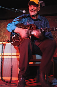 With feet stomping and fingers sliding, Joe Price has been bending notes for over 35 years. | Photo by Julie Staub