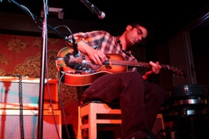 Dustin Busch hits the right chord at the Mill in Iowa City. | Photo by Julie Staub